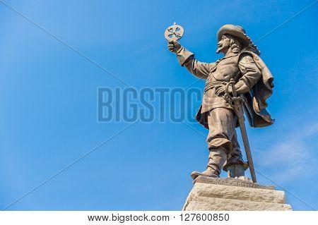 Champlain Statue in Ottawa Canada over blue sky