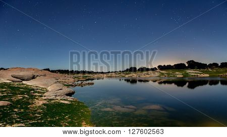 Night picture of a beautiful lake with stars in the sky