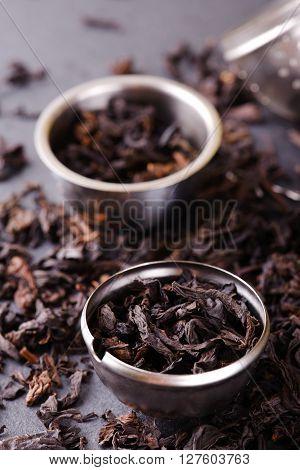 Strainer And Metal Bowl Full Of Dry Tea Leaves
