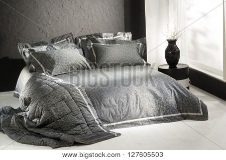 simple minimal and classic style bedroom interior , with black wall and black covers
