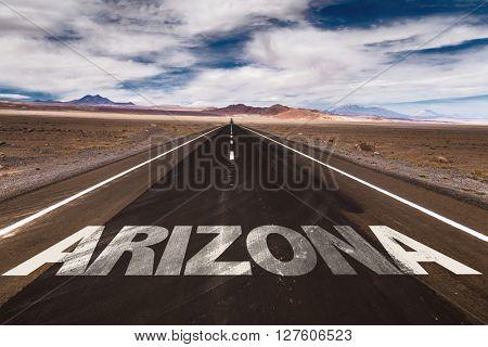 Arizona written on desert road