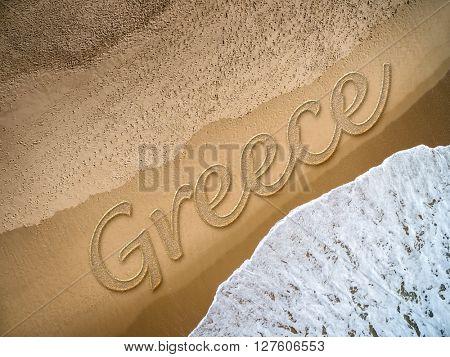 Greece written on the beach