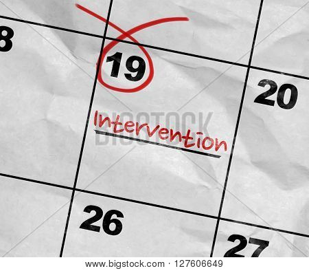 Concept image of a Calendar with the text: Intervention
