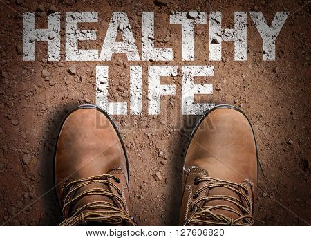 Top View of Boot on the trail with the text: Healthy Life