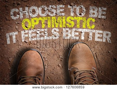 Top View of Boot on the trail with the text: Choose To Be Optimistic It Feels Better