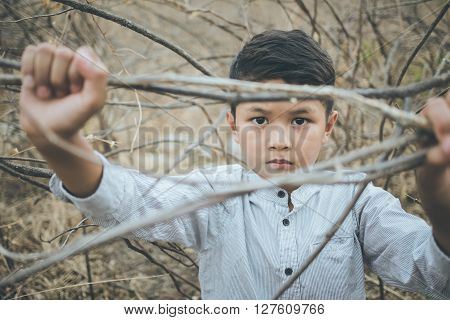 scared and alone, young Asian child, selective focus, vintage