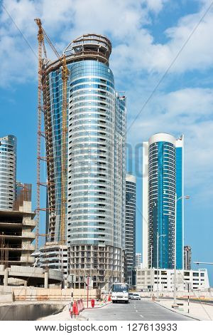 ABU DHABI, UAE - DECEMBER 24: Abu Dhabi Downtown streets with skyscrapers on December 24, 2014. United Arab Emirates