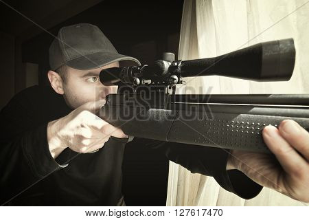 portrait of caucasian sniper with rifle