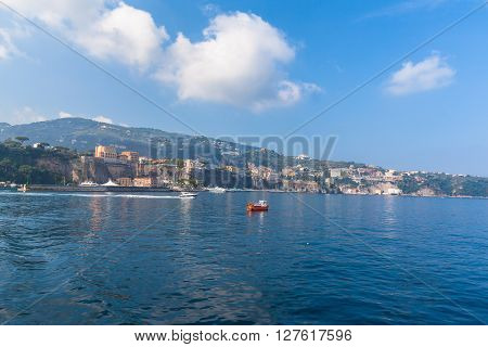 Cityscape of Sorrento on the coast line of Mediterranean sea in southern Italy view from the boat inthe morning sunshine.