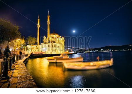 Mosque near the Bosphorus Bridge shot at night. Turkey, Istanbul.