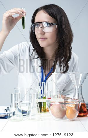 Science and Medicine Concepts. Portrait of Female Lab Staff Dealing With Flasks and Substances in Laboratory Environment. Vertical Image Orientation