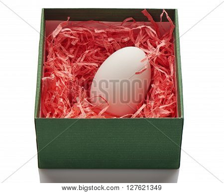 Chicken Egg In Pink Paper Nest Inside A Green Box