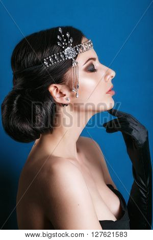 Beauty Fashion Model Retro Girl Over Blinking Background. Vintage Style Woman Portrait. Luxury Lady.