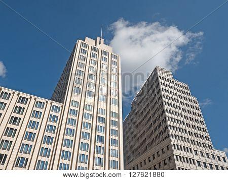 modern skyscraper under a blue sky low angle