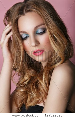 Beauty Model Woman Face On Pink Shiny Background. Perfect Skin. Professional Make-up.blue Eyes And P