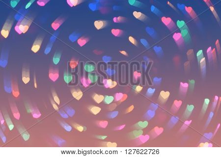 Bokeh hearts lights background. Bokeh whirl defocused pink background. Valentine's day hearts background can be used for web design wallpapers printed products and other.