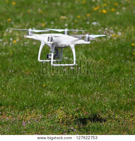 PILSEN CZECH REPUBLIC - APRIL 27, 2016: New drone quadrocopter Dji Phantom 4 with high resolution digital camera and front obstacle sensors. Speed 45mph (72kph). Safe tool for aerial photo and video.