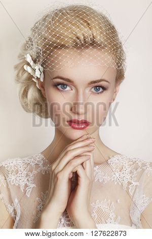 Portrait of beautiful bride. Wedding dress. Wedding decoration.Portrait of a beautiful woman in the image of the bride with flowers in her hair. Picture taken in the studio on a white background.
