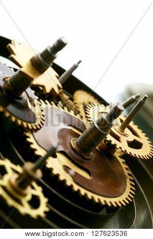 Cogwheels of old clock mechanism macro