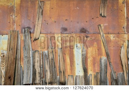 rusty metal and weathered wooden shingles - old building wall background