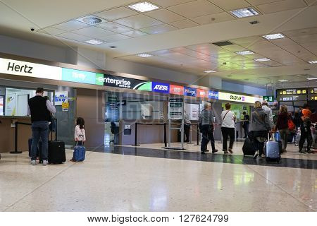 VALENCIA, SPAIN - APRIL 21, 2016: Rental car counter at the Valencia Airport. Approximately 4.98 million passengers passed through the Valencia airport in 2015.