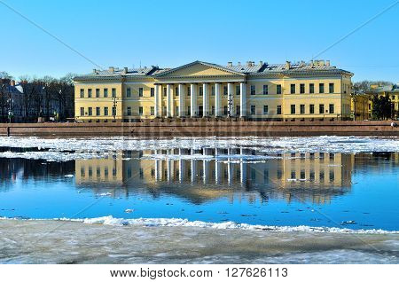 SAINT PETERSBURG, RUSSIA - MARCH 17, 2015. The building of the Academy of Sciences across the Neva river in St Petersburg Russia. Spring architectural landscape of Saint Petersburg.