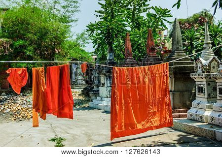 Buddhist monks' robes hanging to dry in Vientiane, Laos