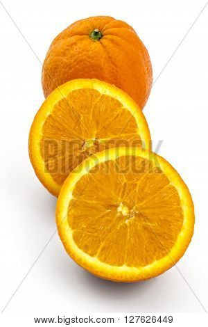 Raw organic orange fruit cutted in half, isolated on white background