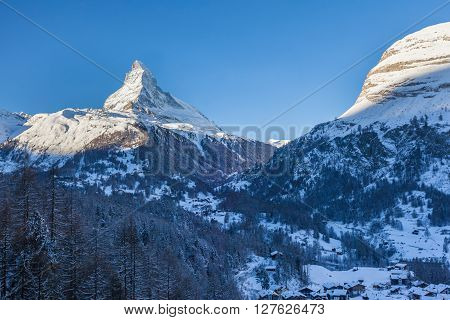 Stunning view of Matterhorn above Zermatt in winter in the morning sunshine Canton of Valais Switzerland.