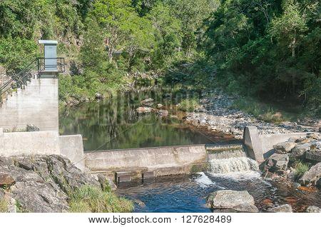 A small concrete dam at the old bridge over the Bloukrans River in the historic Bloukrans Pass