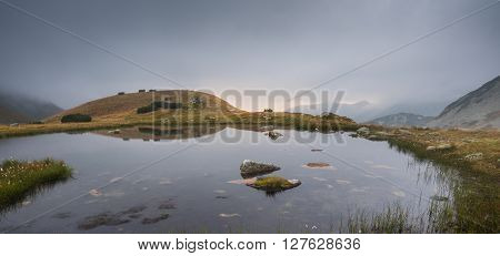 Small Tarn with Rocks in Foggy West Tatra Mountains at Sunset ** Note: Visible grain at 100%, best at smaller sizes
