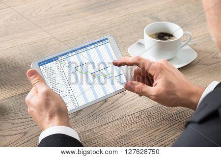 Close-up Of Businessman Working On Digital Tablet