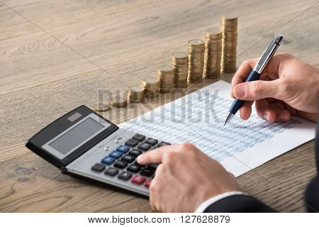 Close-up Of A Businessman Analyzing Financial Report