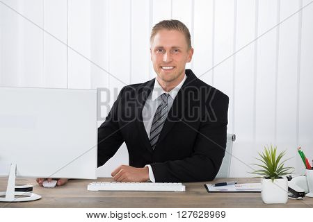 Businessman Smiling At Work In Office