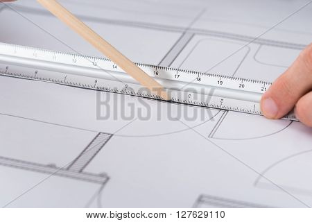 Close-up Of Architect Hand Working On Blueprint In Office