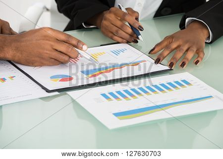 Graphs And Charts Analyzed By Businesspeople