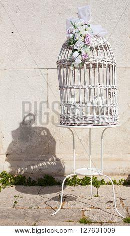 Two doves inside the jailbird decoration for wedding