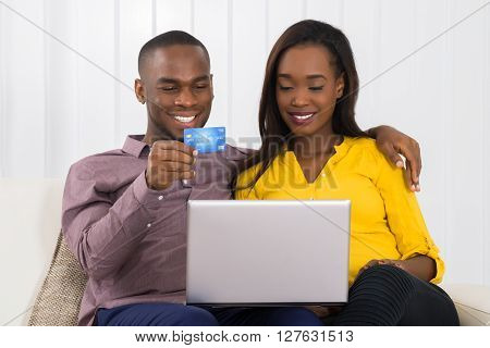 Happy Couple Shopping Online With Credit Card