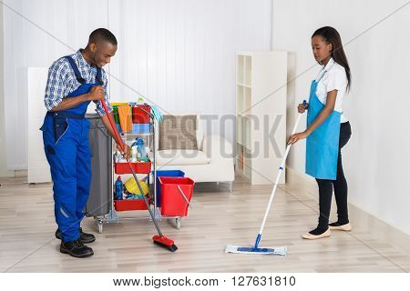 Janitors Cleaning Apartment