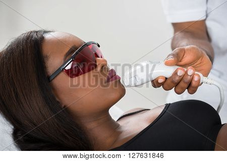 Woman Receiving Epilation Laser Treatment On Face