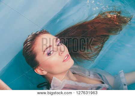 Portrait Of Sexy Seductive Woman In Water.
