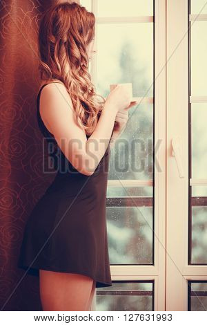 Pensive Woman Drinking Hot Coffee Beverage At Home