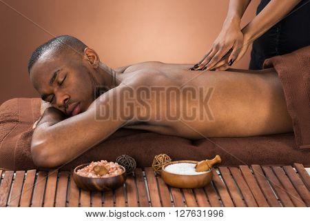 Man Getting Massage In Spa
