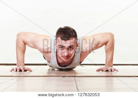 Sports man making pushups. Care about health and body