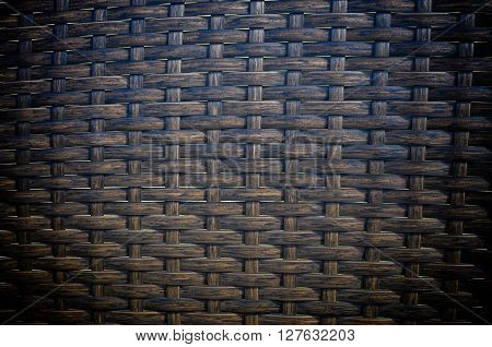 Background texture of brown wicker pattern close up.