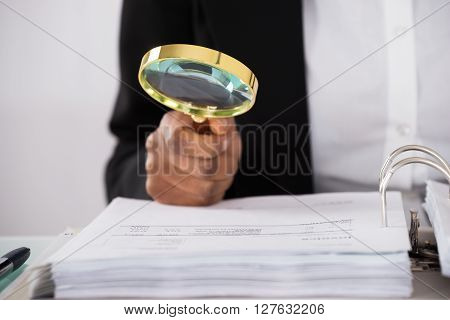 Businesswoman Hand Examining Invoice
