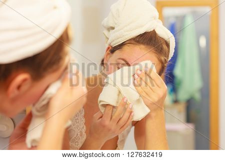 Woman Washing Face In Bathroom. Hygiene