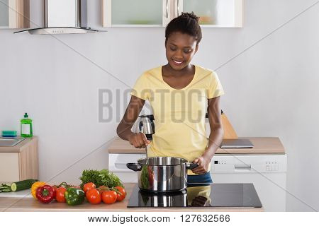 Woman Cooking Meal In Kitchen