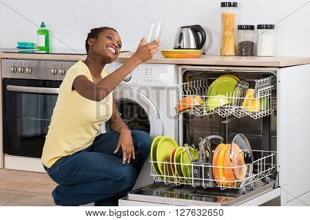 Happy African Woman Looking At Clean Glass