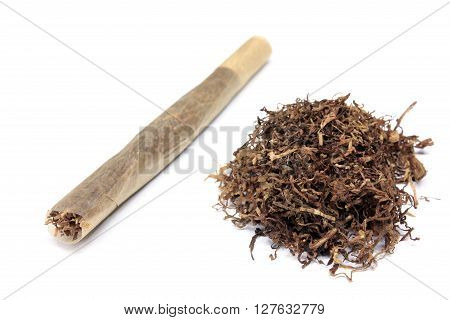 Handmade cigarette in rice paper and tobacco isolated on white background